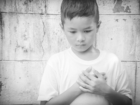 sad heart: Young Asian homeless child looking scared, alone and in need of help Stock Photo