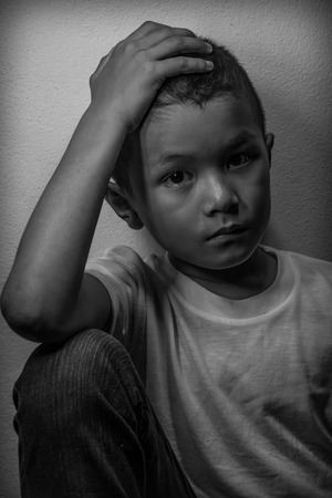 young: Young Asian homeless child looking scared, alone and in need of help Stock Photo
