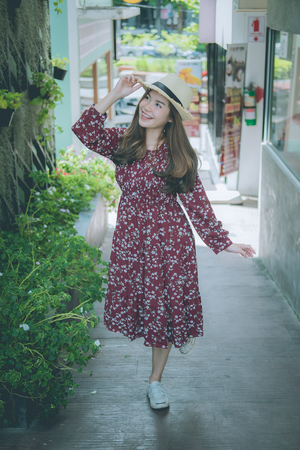 beautiful young asian girl have a happy time alone , vintage tone,  free happy woman enjoying nature, beauty girl outdoor, freedom concept,