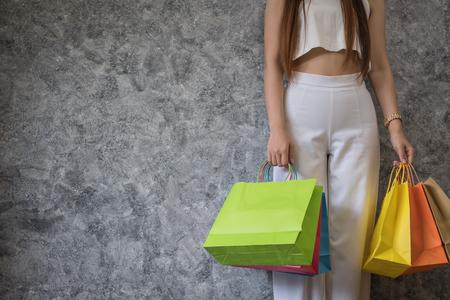 Happy beautiful young asian woman doing shopping, shopping concept