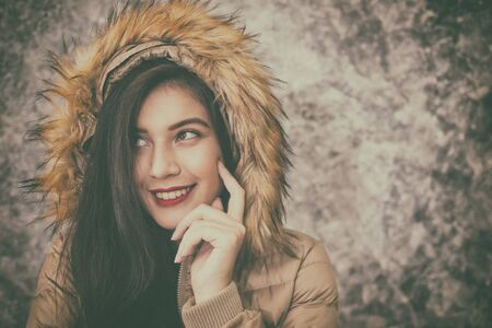 beautiful young woman wearing warm fashionable winter clothes to keep her from the cold