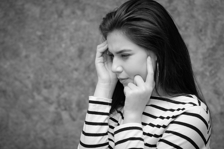 desperation: Young beautiful girl looking anxious, stressed and nervous Stock Photo
