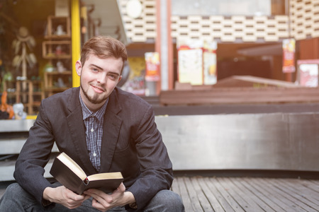 Closeup on a man reading a bible at shopping mall, believe concept Stock Photo