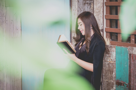 Closeup on a young asian woman holding a bible and pray, believe concept
