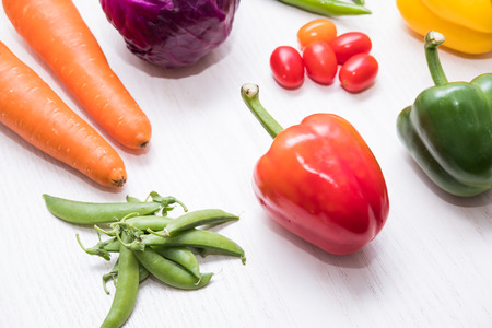 A selection of fresh vegetables for a heart healthy diet as recommended by doctors and medical professionals Stock Photo