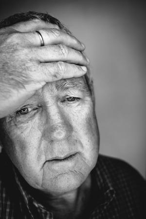 Close up face portrait Older depressed man