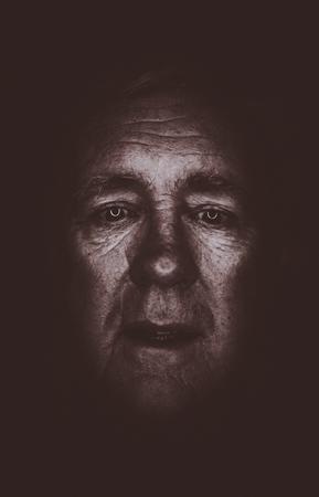 older man sadness alone in the darkside