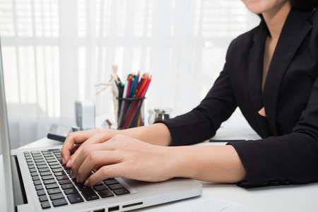 Young Asian woman working at a desk in business sector Zdjęcie Seryjne