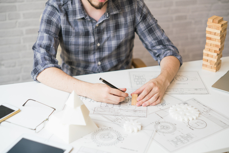 Young architect working hard on a new project and concept Stock Photo