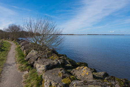 View over the lake on a day with clear blue skies Stock Photo