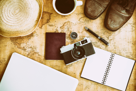 Creative flatlay with fashion object on map background