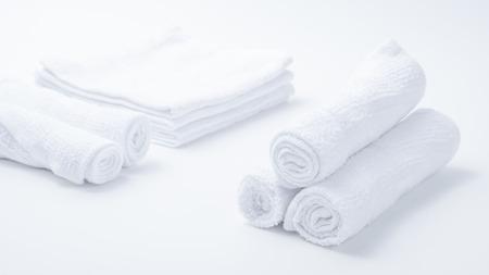 Rolled up white spa towels, selective focus, vintage Zdjęcie Seryjne