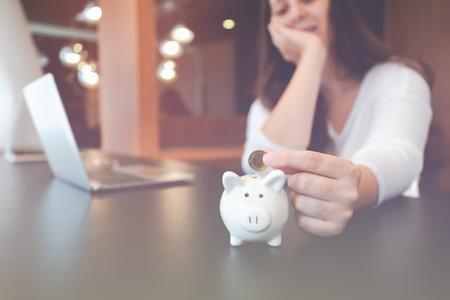 Beautiful young business girl saving money for holiday season