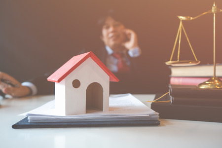 Discuss the problem of selling a home with a lawyer