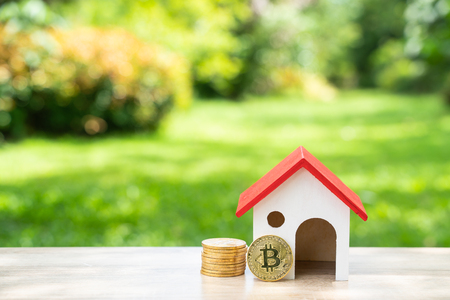 saving Money and bitcoin From Online Business To buy a house in the future Stock Photo