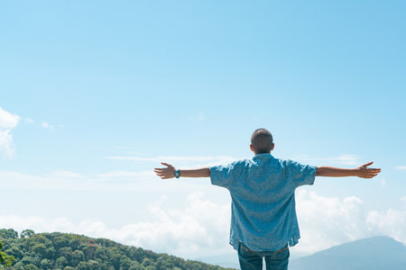 Boy is standing See the sky and the mountains and be free