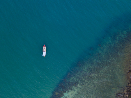 Small boats fishing in the blue ocean
