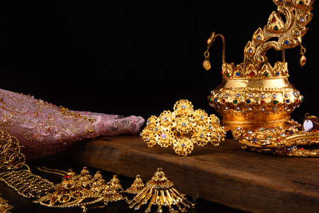 gold ornaments: Traditional dress of Thai women Stock Photo