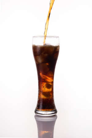 tall glass: pouring soft drink splash into tall glass on white background Stock Photo