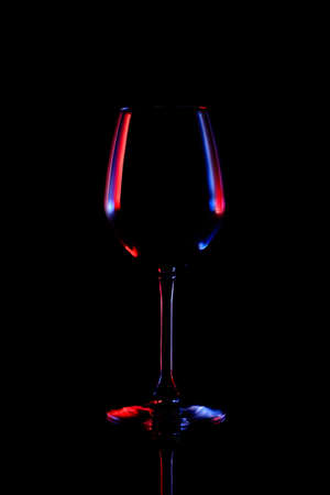 low glass: Wine glass object in low key style on black background