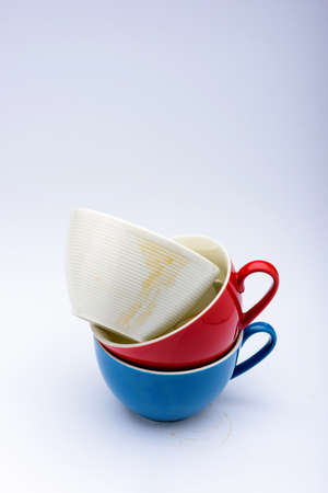 coffee stains: empty whiteredblue coffee cup with coffee stains on white background
