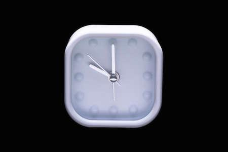 o'clock: Ten oclock on white alarm clock on black background