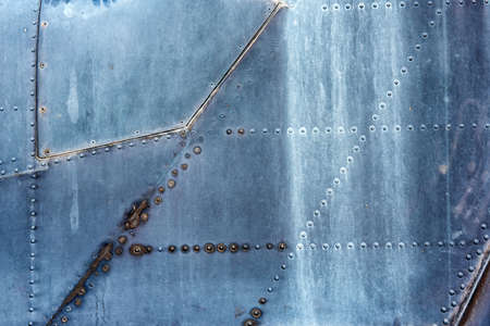 aircraft rivets: metallic background with Rivets,sign, part of the old aircraft Stock Photo