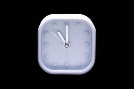 o'clock: Eleven oclock on white alarm clock on black background
