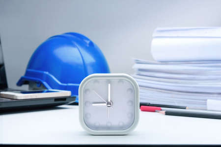 lap top: Clock, helmet,lap top,Blue print,Phone,pen on table architectural project Stock Photo