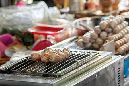 isaan: Thai rice ball sausage  street food in Thailand Stock Photo