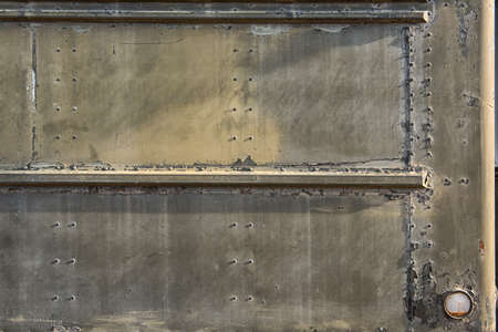armoring: metallic background with Rivets,sign, part of the old Military vehicle Stock Photo