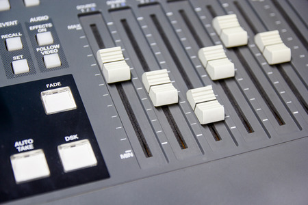 switcher: mixing console button switcher controlling broadcast Stock Photo