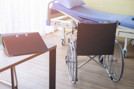 Wheelchair and bed of patient Room in the hospital ,healthy and life concept
