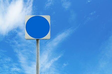 blank blue sign board on sky background.