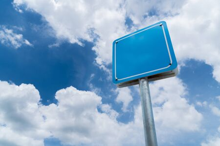 Blank sign with blue sky background.