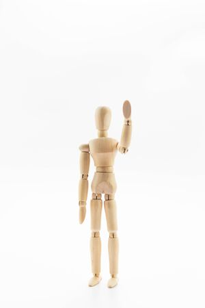 Wooden mannequin on white background.