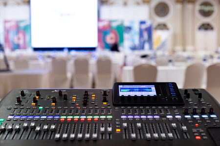Professional Audio Sound Mixing Console Faders in seminar room. Redactioneel
