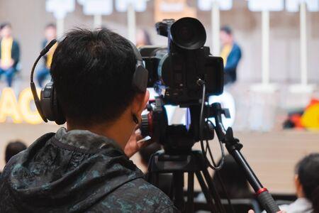 professional cameraman recording professional video camera. Standard-Bild - 134095749