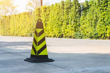traffic cone, stripes on road, copy space. Standard-Bild - 135232788