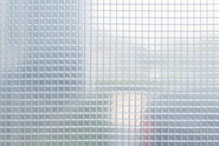 clear sheet square plastic pattern, texture, background. Standard-Bild - 135232794