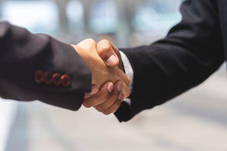 close up businessman man and businesswoman handshake for partner, Business concept. Standard-Bild - 135232789