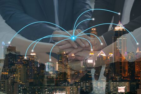 Double exposure of business team connect joining hands and city night with network connection partner. business concept. Standard-Bild - 135232795