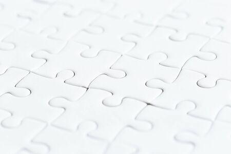 close up white jigsaw game puzzle. Standard-Bild - 138145730