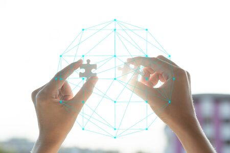Connect jigsaw pieces to create network connection silhouette sunset with connect dots Polygonal, Business concept. Standard-Bild - 138145925