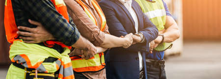Teamwork engineer technician and foreman shaking hands work successful, connection partnership successful concept.