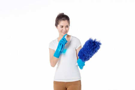 portrait of young maid holding cleaning spray bottle, isolated on white background