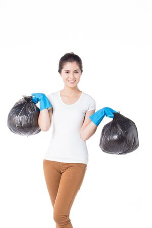 portrait of young maid holding with garbage bag on hand, white background