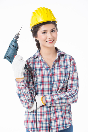 Industrial worker woman with driller . Isolated over white background