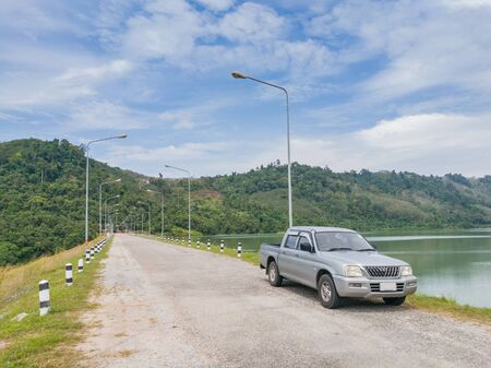 Car parking on Compacted concrete dam in Thailand