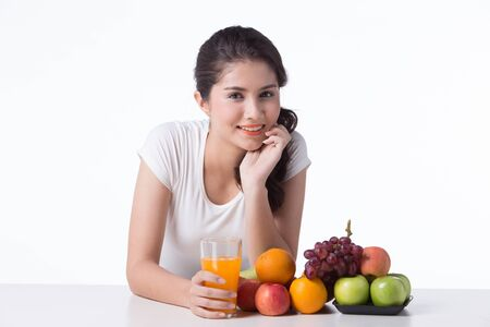 beautiful woman with healthy food, white background isolate Banco de Imagens